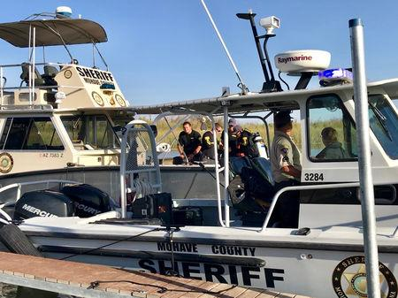 Mohave County Sheriff's Office search and rescue boats look for four people missing on the Colorado River north of Lake Havasu in Arizona