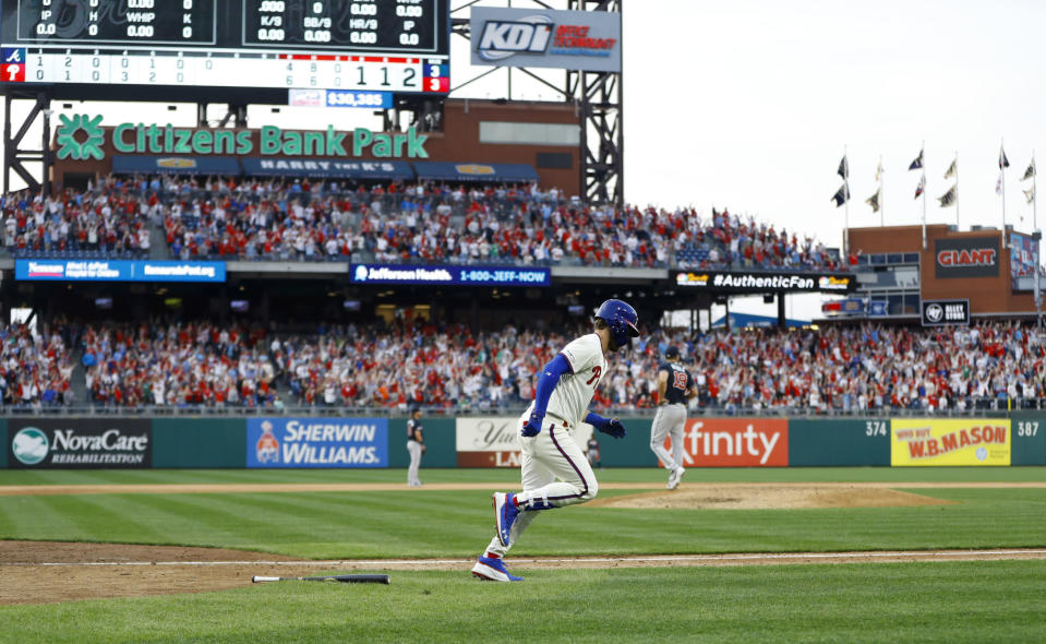 Philadelphia Phillies' Bryce Harper, center, rounds the bases after hitting a home run off Atlanta Braves relief pitcher Jesse Biddle during the seventh inning of a baseball game, Saturday, March 30, 2019, in Philadelphia. (AP Photo/Matt Slocum)