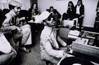 <p>Stevie Wonder backstage at the Rainbow Theatre, using a cassette player, on January 30, 1974 in London.</p>