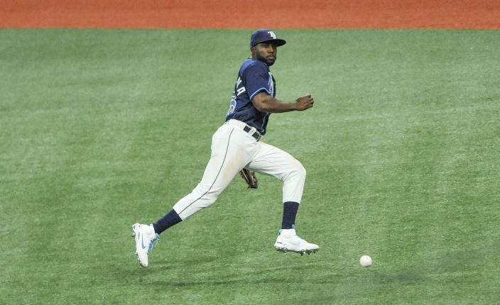 Tampa Bay Rays right fielder Randy Arozarena chases a RBI-double hit by Texas Rangers' Charlie Cuberson during the fourth inning of a baseball game Tuesday, April 13, 2021, in St. Petersburg, Fla. (AP Photo/Steve Nesius)