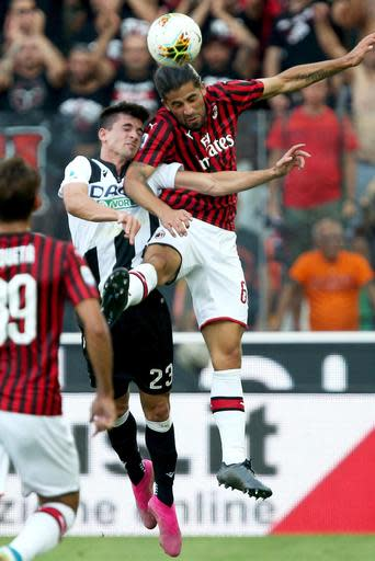 Udinese's Ignacio Pussetto, left, and Milan's Ricardo Rodriguez vie for the ball during the Italian Serie A soccer match between Udinese and AC Milan at the Friuli stadium in Udine, Italy, Sunday, Aug. 25, 2019. (Gabriele Menis/ANSA via AP)