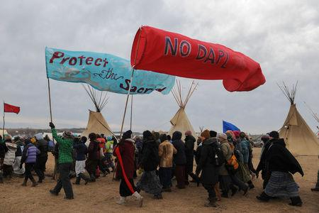 People march in Oceti Sakowin camp during a protest against plans to pass the Dakota Access pipeline near the Standing Rock Indian Reservation, near Cannon Ball, North Dakota, U.S. November 27, 2016. REUTERS/Stephanie Keith