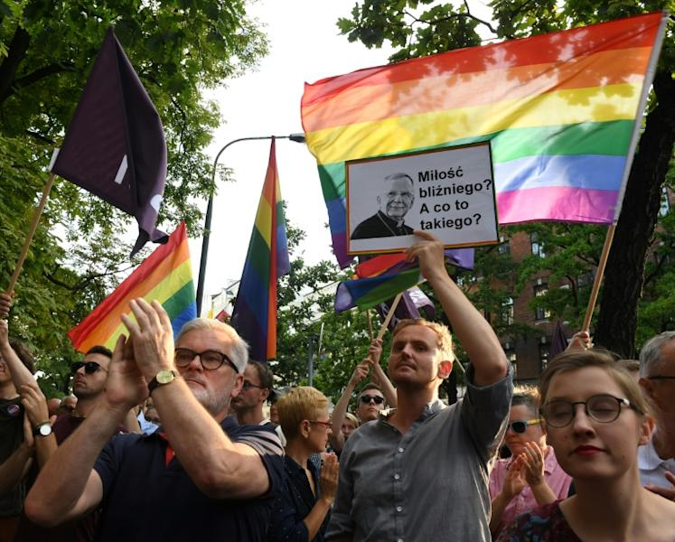 "Protesters demand the resignation of Krakow Archbishop Marek Jedraszewski who stirred outrage by warning against an ""LGBT plague"" in Poland (AFP Photo/Janek SKARZYNSKI)"