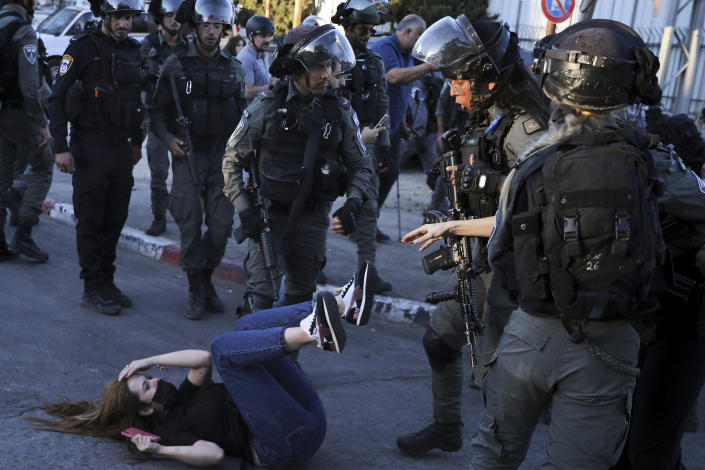 Israeli police scuffle with protesters in the Sheikh Jarrah neighborhood of east Jerusalem Saturday, May 15, 2021. The tensions began in east Jerusalem earlier this month, when Palestinians protested attempts by settlers to forcibly evict a number of Palestinian families from their homes. (AP Photo/Mahmoud Illean)
