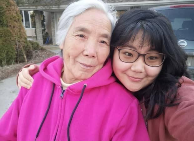 Emily Tang (right) said her grandmother Fenglan Ge (left) was her main caregiver growing up as her single mom worked long hours at a hospital and now works with social services. (Submitted by Emily Tang - image credit)