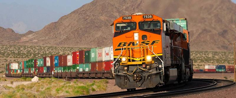 A BNSF Railway intermodal train twists through the Mojave desert.
