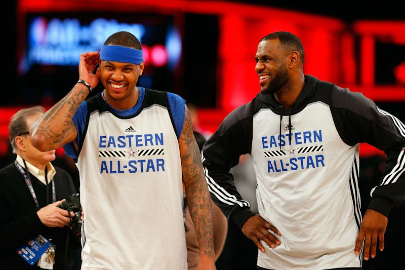 Carmelo Anthony and LeBron James laugh together in Eastern All-Star shirts.