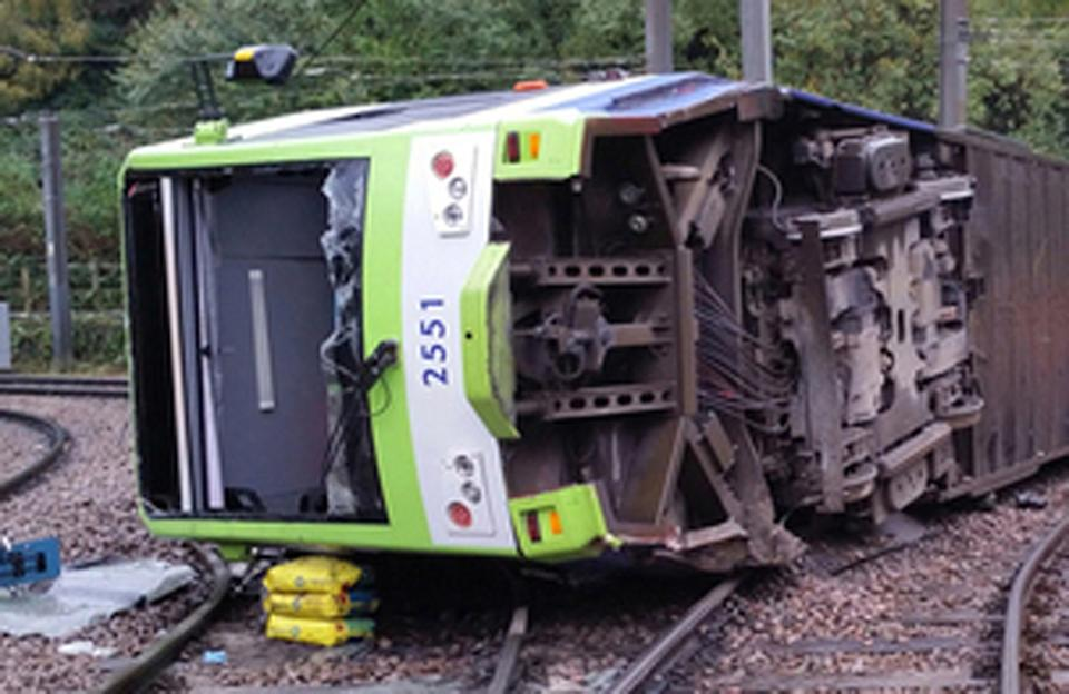 <p>A file photo issued by the Rail Accident Investigation Branch of the derailed tram</p> (PA)