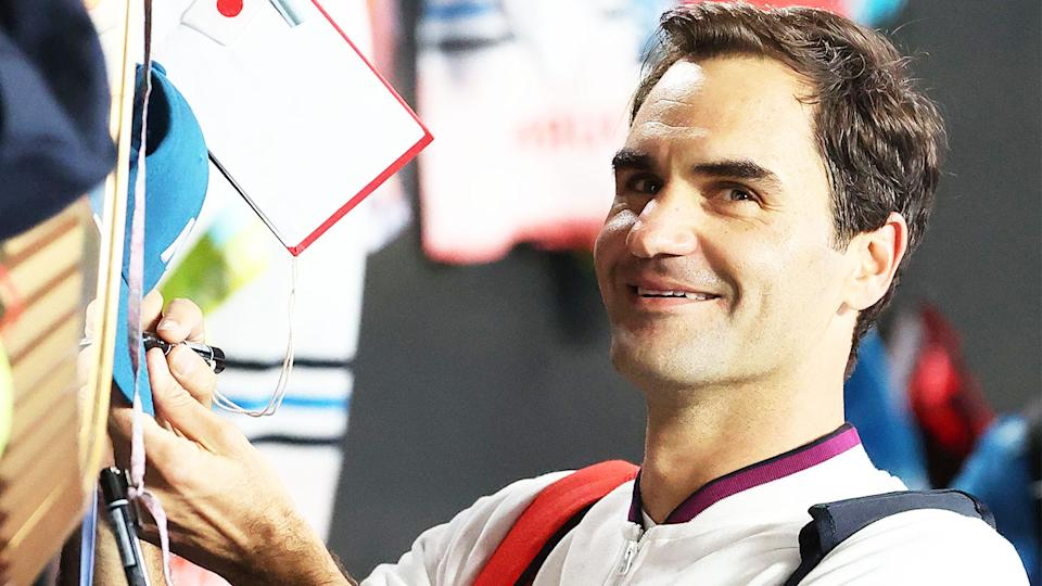 Roger Federer (pictured) signing autographs at the Australian Open.