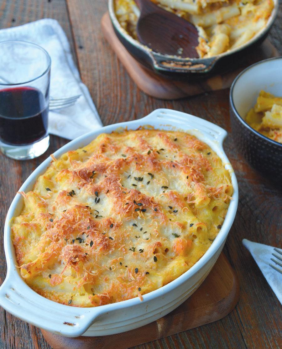 """<p>There are two versions of this <a href=""""http://ediblerhody.ediblefeast.com/recipes/farmers-mac-n-cheese"""" rel=""""nofollow noopener"""" target=""""_blank"""" data-ylk=""""slk:classic favorite recipe"""" class=""""link rapid-noclick-resp"""">classic favorite recipe</a>: Farmers' Mac 'n' Cheese with Butternut Squash and a variation with Turnip and Lacinto Kale.</p><p><i>(Photo: Amy McCoy for <a href=""""http://ediblerhody.ediblefeast.com"""" rel=""""nofollow noopener"""" target=""""_blank"""" data-ylk=""""slk:Edible Rhody"""" class=""""link rapid-noclick-resp"""">Edible Rhody</a>)</i></p>"""