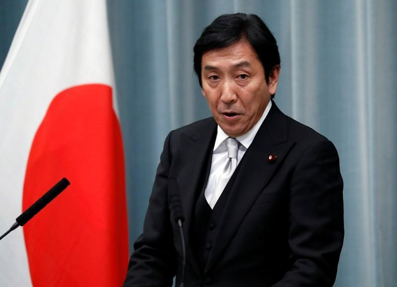 Japan's Economy, Trade and Industry Minister Sugawara attends a news conference at PM Abe's official residence in Tokyo