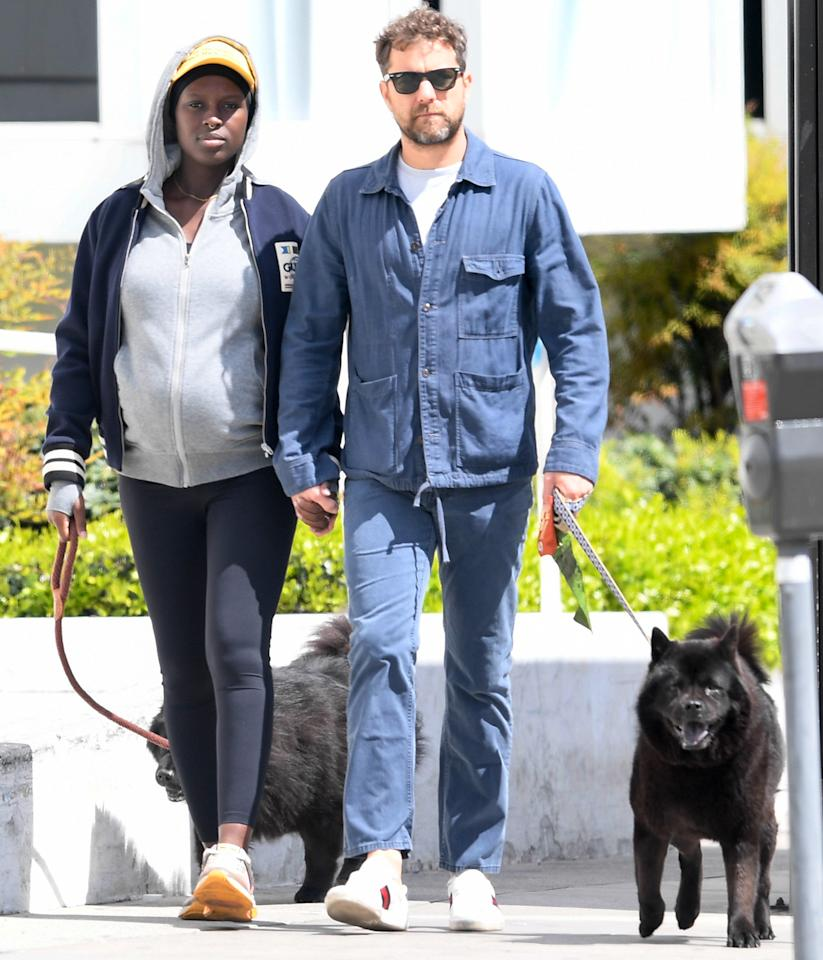 <p>Joshua Jackson and Jodie Turner-Smith — due with their first child together on Thursday — keep things moving with their dogs in L.A. on Wednesday.</p>