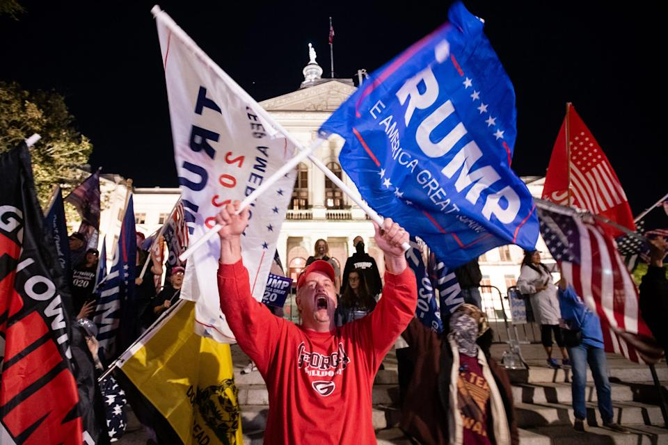 A supporter of President Trump yells at counterprotesters across the street during a rally to protest the election results outside the Georgia State Capitol on Nov. 14. President-elect Joe Biden has been declared the winner in Georgia, becoming the first Democratic nominee to win the state since 1992.