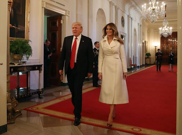 <p>The First Lady arrives at the Women's History Month event hosted at The White House. She dressed for the occasion in white - a color of the women's suffrage movement - modeling a coat by The Row. She completes the outfit with a pair of Christian Louboutin heels.</p>