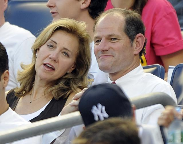 File photo of former New York Governor Spitzer and his wife sitting behind home plate before New York Yankees plays against Texas Rangers in New York