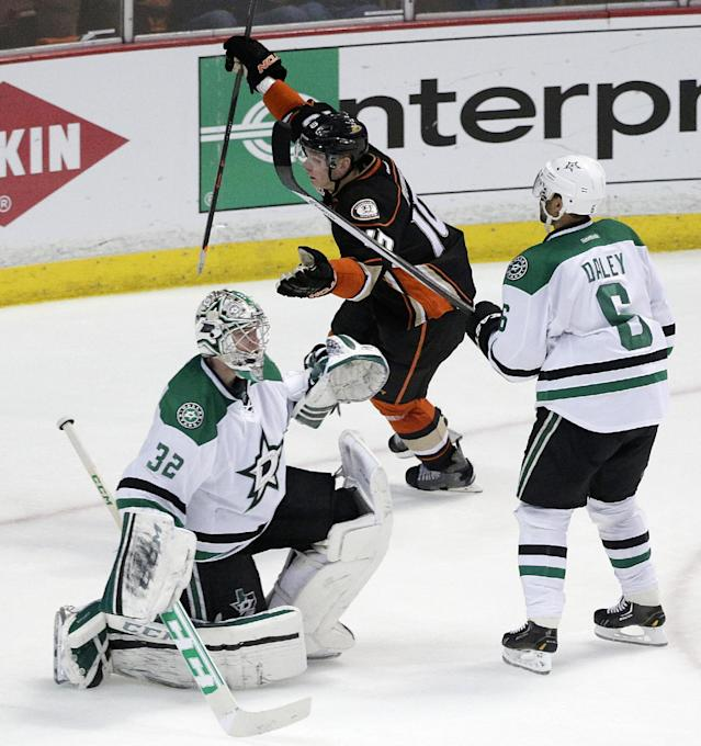 Anaheim Ducks' Corey Perry, center, celebrates his goal as he skates past Dallas Stars goalie Kari Lehtonen, left, of Finland, and Stars' Trevor Daley during the second period in Game 2 of the first-round NHL hockey Stanley Cup playoff series, Friday, April 18, 2014, in Anaheim, Calif. (AP Photo/Jae C. Hong)