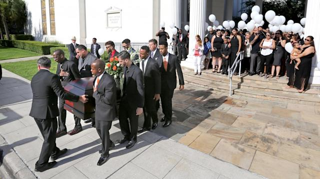 <p>Pallbearers carry the casket as the family leaves the funeral of Pulse shooting victim Brenda Lee Marquez McCool at First United Methodist Church in downtown Orlando, Fla., on June 20, 2016. (Joe Burbank/Orlando Sentinel via AP) </p>