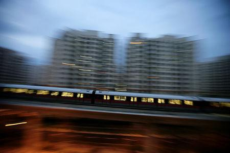 FILE PHOTO: An MRT train travels along a track in a neighbourhood in Singapore