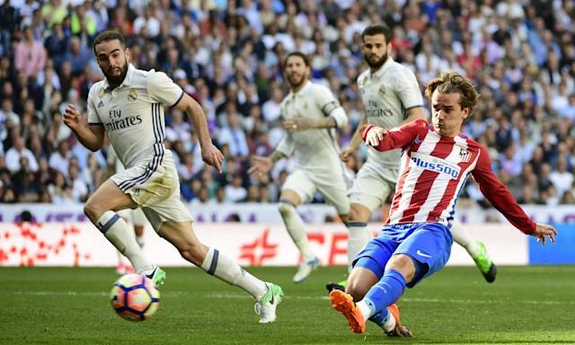 "<span class=""element-image__caption"">Antoine Griezmann scores Atlético Madrid's equaliser with five minutes to go to deny Real victory in the Madrid derby at the Bernabéu Stadium.</span> <span class=""element-image__credit"">Photograph: Pierre-Philippe Marcou/AFP/Getty Images</span>"