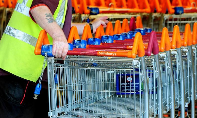 Sainsbury's worker with shopping trolleys