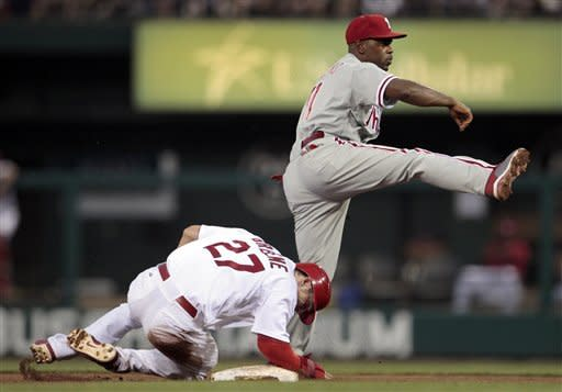 Philadelphia Phillies shortstop Jimmy Rollins, top, avoids the slide by St. Louis Cardinals' Tyler Greene while turning the double play during the third inning of a baseball game Friday, May 25, 2012, in St. Louis. Matt Holliday was out at first. (AP Photo/Jeff Roberson)
