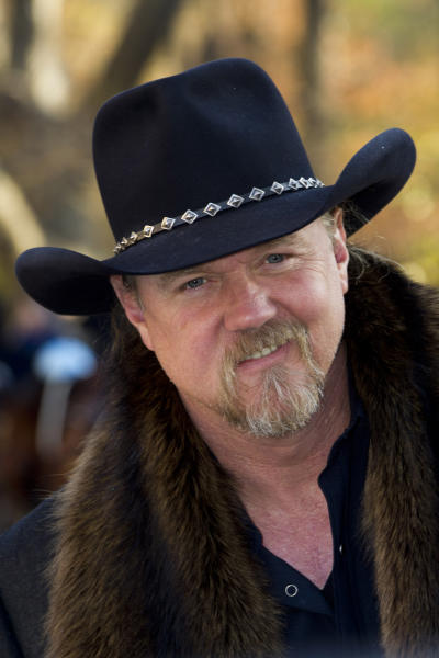 FILE - In this Thurs., Nov. 22, 2012 file photo,Trace Adkins arrives to the Macy's Thanksgiving Day Parade in New York. Trace Adkins wore an earpiece decorated like the Confederate flag when he performed for the Rockefeller Center Tree Lighting on Nov. 28, but he said he didn't mean to offend anyone by wearing it. (AP Photo/Charles Syke, File)