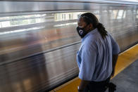 Desmond Hill, a vaccinated MTA conductor, waits to switch trains at the end of the line as he works the N subway line from Brooklyn's Coney Island to Queen's Astoria-Ditmars neighborhoods, Friday, Aug. 13, 2021, in New York. As New York City recovers from the COVID-19 pandemics' peak ridership on the aging transit system continues to rebound as authorities encourage mask and social distancing protocols to stem further transmission of the virus. (AP Photo/John Minchillo)