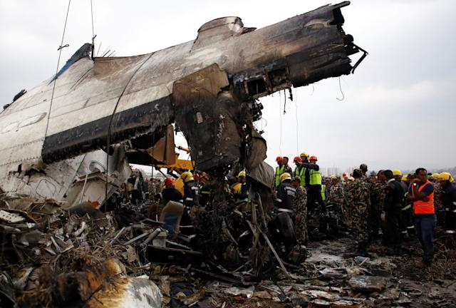 <p>Rescue workers work at the wreckage of a US-Bangla airplane after it crashed at the Tribhuvan International Airport in Kathmandu, Nepal, March 12, 2018. (Photo: Navesh Chitrakar/Reuters) </p>