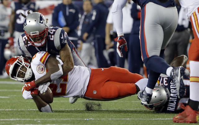 <p>New England Patriots defensive backs Stephon Gilmore (24) and Jordan Richards (37) tackle Kansas City Chiefs running back Kareem Hunt (27) during the first half of an NFL football game, Thursday, Sept. 7, 2017, in Foxborough, Mass. (AP Photo/Steven Senne) </p>