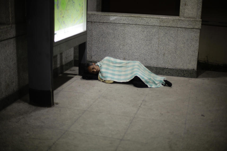 A man sleeps near the entrance of an MRT station in Singapore. (Reuters file photo)