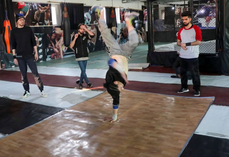 Afghan youth practise breakdancing during a training session in Kabul