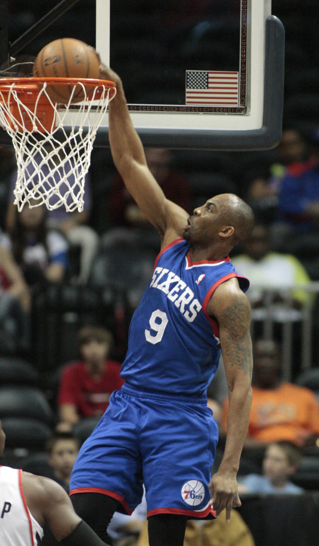 Philadelphia 76ers guard James Anderson (9) dunks in the first half of an NBA basketball game against the Atlanta Hawks Monday, March 31, 2014, in Atlanta. (AP Photo/Jason Getz)