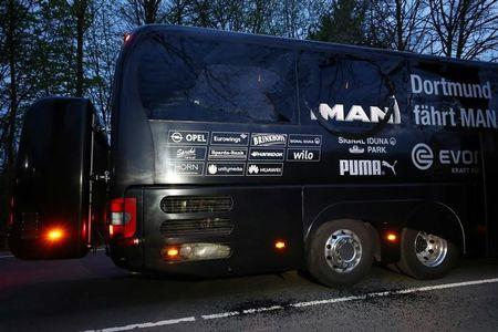 FILE PHOTO - The Borussia Dortmund team bus is seen after an explosion near their hotel before the game