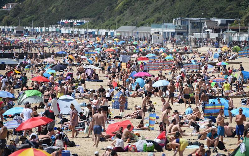 The beachThe Monday sunshine saw people flocking to the Dorset resort of Bournemouthes were packed - Getty