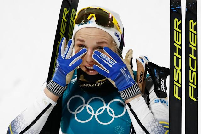 <p>Gold medalist Sweden's Stina Nilsson reacts during the victory ceremony in the women's cross-country individual sprint classic final at the Alpensia cross country ski centre during the Pyeongchang 2018 Winter Olympic Games on February 13, 2018 in Pyeongchang. / AFP PHOTO / Odd ANDERSEN </p>