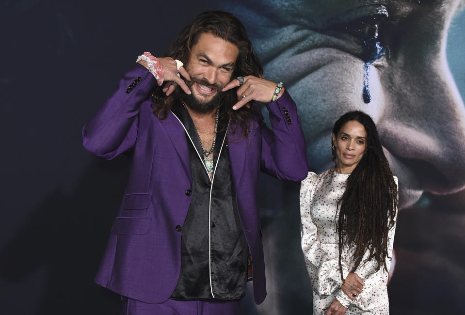 "Jason Momoa, left, and Lisa Bonet arrive at the Los Angeles premiere of ""Joker"" at TCL Chinese Theatre on Saturday, Sept. 28, 2019. (Photo by Jordan Strauss/Invision/AP)"