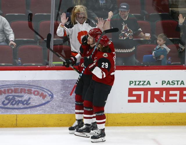 Arizona Coyotes left wing Lawson Crouse, left, celebrates his goal against the San Jose Sharks with right wing Mario Kempe (29) during the first period of an NHL hockey game Wednesday, Jan. 16, 2019, in Glendale, Ariz. (AP Photo/Ross D. Franklin)