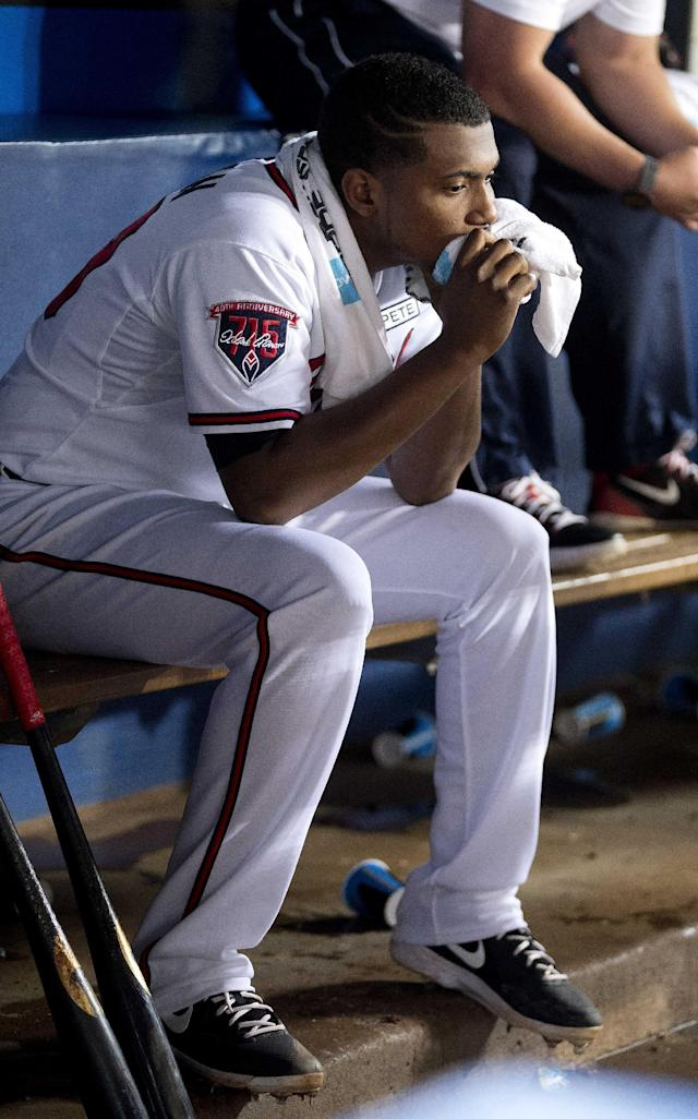 Atlanta Braves starting pitcher Julio Teheran (49) sits on the bench after being relieved in the eighth inning of a baseball game against the Los Angeles Dodgers Monday, Aug. 11, 2014 in Atlanta. (AP Photo/John Bazemore)