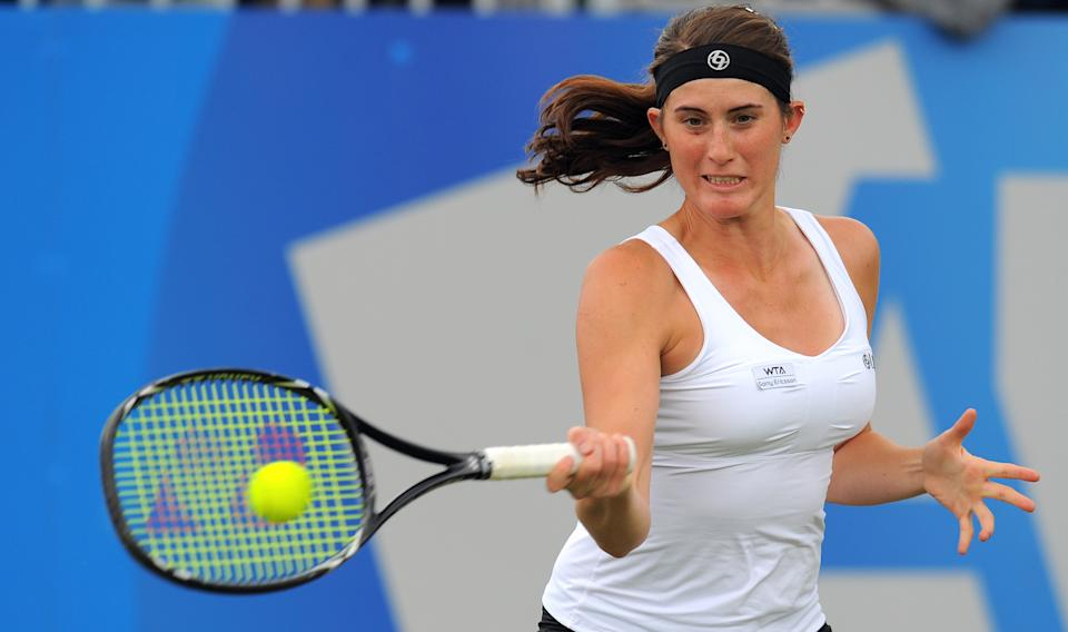 Canada's Rebecca Marino returns to Serbia's Ana Ivanovic at Birmingham in June, 2011. (ANDREW YATES/AFP/Getty Images)