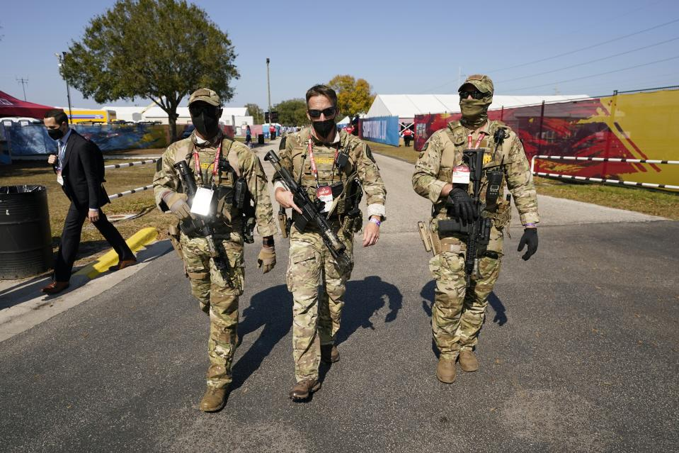 Security personnel arrive before the NFL Super Bowl 55 football game between the Kansas City Chiefs and Tampa Bay Buccaneers, Sunday, Feb. 7, 2021, in Tampa, Fla. (AP Photo/Mark Humphrey)