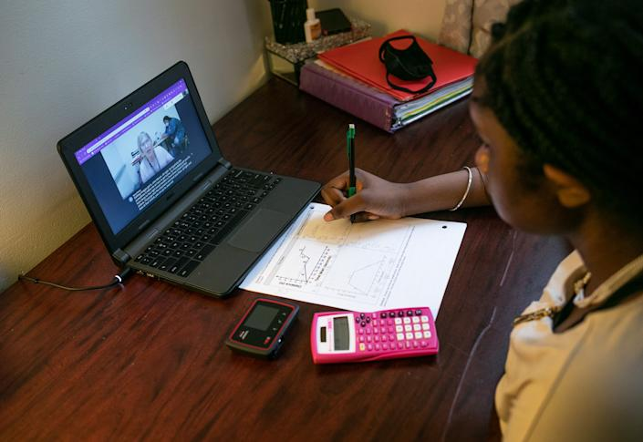 Abigail Previlon, 13, takes part in remote distance learning with her deaf education teacher Diane Gamse on October 28, 2020 in Stamford, Connecticut. (John Moore/Getty Images)