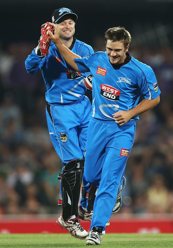HOBART, AUSTRALIA - JANUARY 05: Cameron Boyce and Tim Ludeman of the Strikers celebrate the wicket of Ricky Ponting of the Hurricanes during the Big Bash League match between the Hobart Hurricanes and the Adelaide Strikers at Blundstone Arena on January 5, 2013 in Hobart, Australia.  (Photo by Mark Metcalfe/Getty Images)