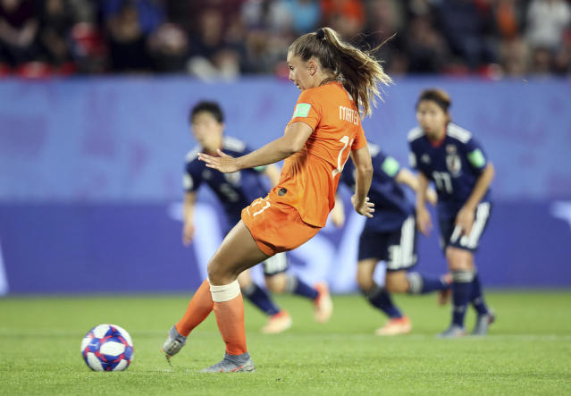 Netherlands' Lieke Martens scores her side's second goal from the penalty spot during the Women's World Cup round of 16 soccer match between the Netherlands and Japan at the Roazhon Park, in Rennes, France, Tuesday, June 25, 2019. (AP Photo/David Vincent)