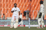 India's Rishabh Pant, left, celebrates scoring a century during the second day of fourth cricket test match between India and England at Narendra Modi Stadium in Ahmedabad, India, Friday, March 5, 2021. (AP Photo/Aijaz Rahi)