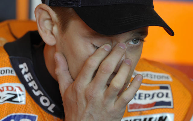 Repsol Honda Team Australian rider Casey Stoner gestures before the Moto GP free practice 3 of the Portuguese Grand Prix in Estoril, outskirts of Lisbon, on May 5, 2012. AFP PHOTO / MIGUEL RIOPAMIGUEL RIOPA/AFP/GettyImages