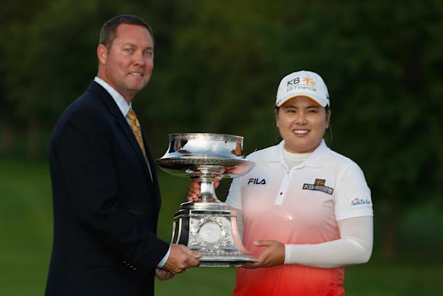 PITTSFORD, NY - JUNE 09: Commissioner Mike Whan poses with Inbee Park of South Korea after Park won the Wegmans LPGA Championship at Locust Hill Country Club on June 9, 2013 in Pittsford, New York (Photo by Scott Halleran/Getty Images)