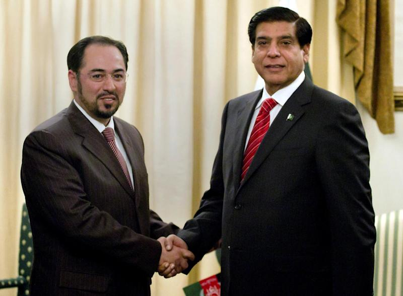 Salahuddin Rabbani, left, head of Afghanistan High Peace Council, shakes hand with Pakistan's Prime Minister Raja Pervaiz Ashraf, for the benefit of the media prior to their meeting in Islamabad, Pakistan, Monday, Nov. 12, 2012. A delegation of Afghanistan High Peace Council headed by Rabbani is in Islamabad to hold talks with Pakistan leadership to discuss peace and the reconciliation process in Afghanistan. (AP Photo/Anjum Naveed)
