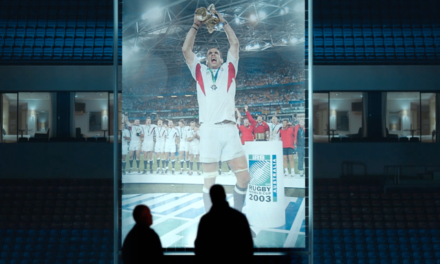 The iconic photo is projected onto a giant screen in Twickenham Stadium. Photo: Canon