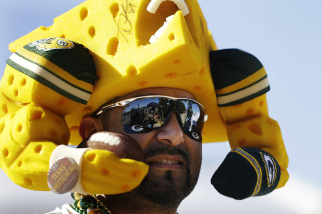 Green Bay Packers fan Richard Llanes shows support for his team before an NFL football game against the Dallas Cowboys, Sunday, Dec. 15, 2013, in Arlington, Texas. (AP Photo/Tim Sharp)