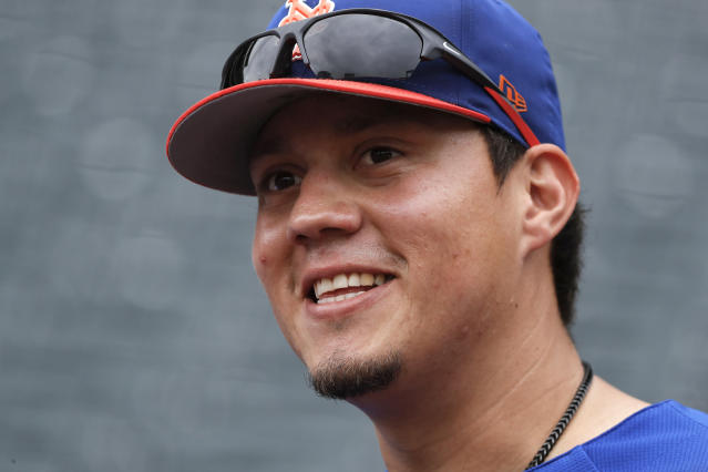 File-This June 27, 2018, file photo shows New York Mets' Wilmer Flores (4) before a baseball game against the Pittsburgh Pirates in New York. Flores and the Arizona Diamondbacks have finalized a one-year contract that guarantees $4.25 million. Flores gets a $3.75 million salary this year as part of the deal, which includes a $6 million team option for 2020 with a $500,000 buyout. Flores can earn performance bonuses based on plate appearances in 2019. He became a free agent last month when the New York Mets failed to offer a 2019 contract.(AP Photo/Julie Jacobson, File)